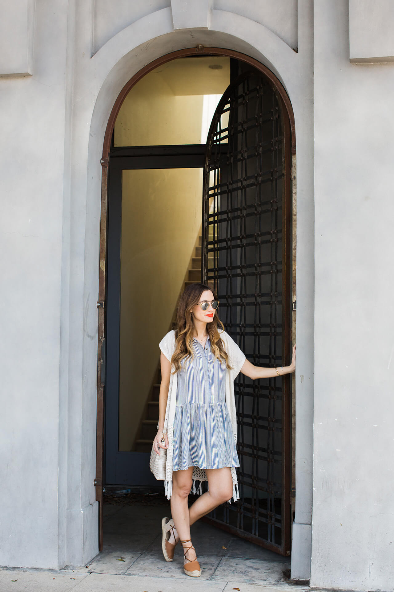 fringe cardigan with striped shirtdress for a coffee on larchmont