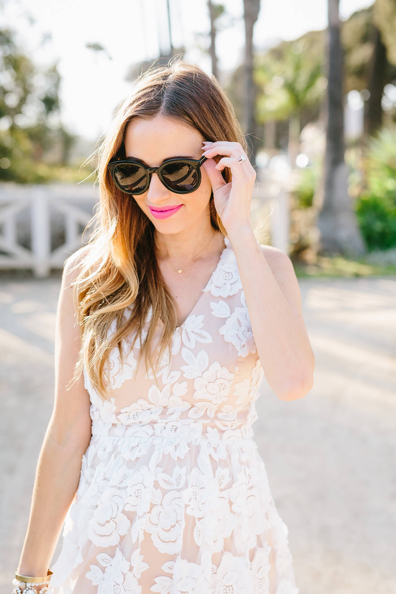 girly dress with bold black sunglasses