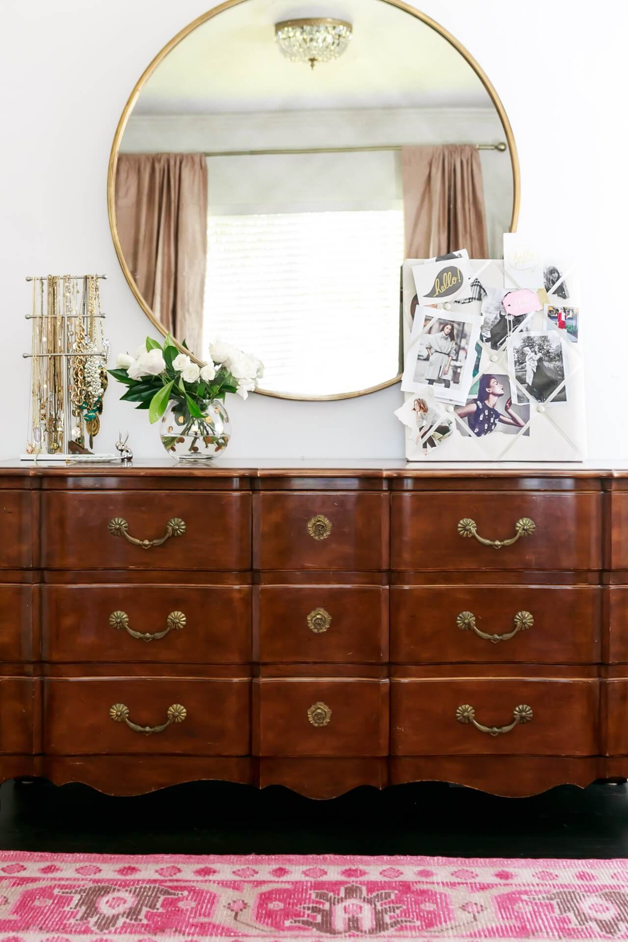 vintage dresser with inspiration board and round mirror