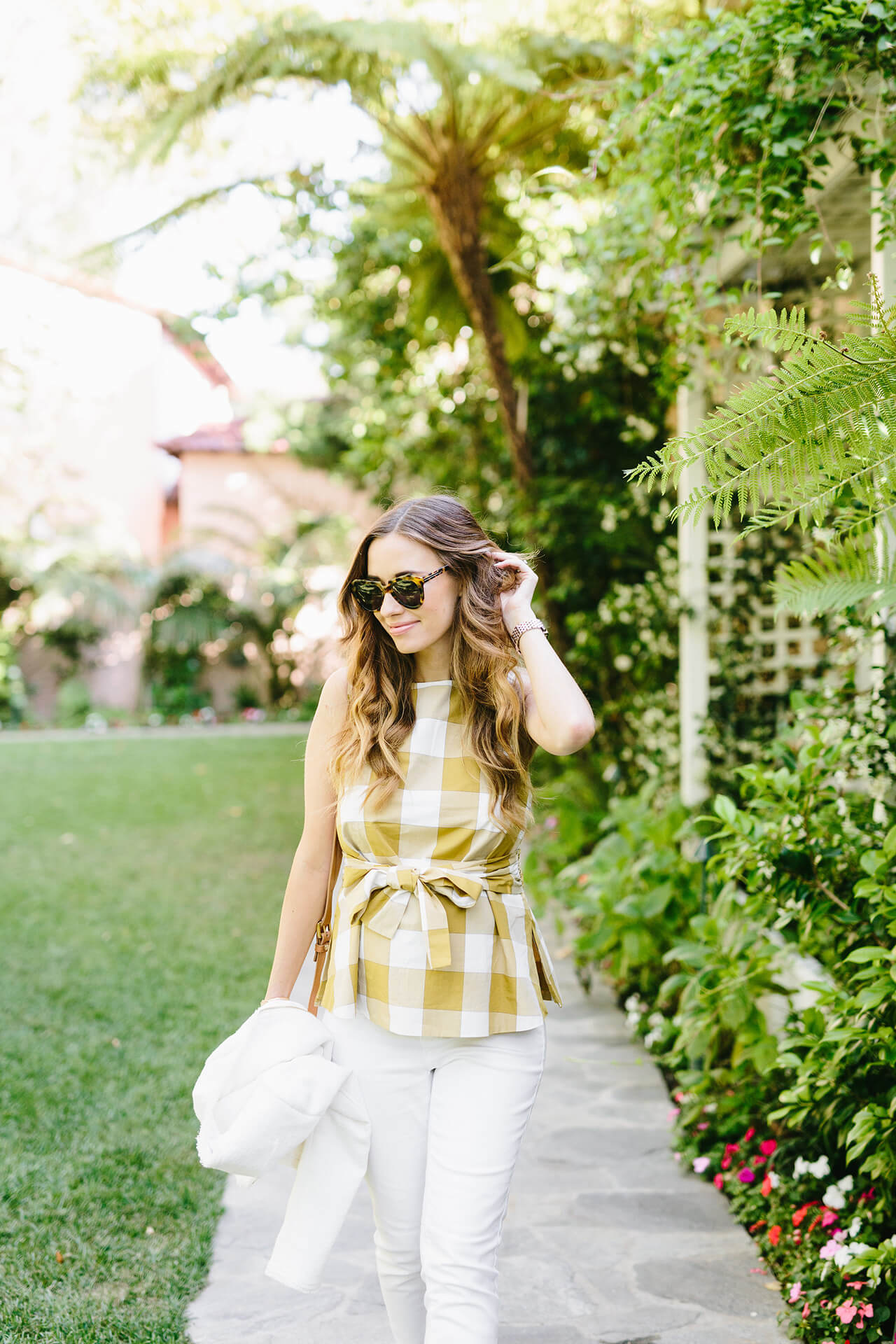 gingham blouse with bow and white jeans