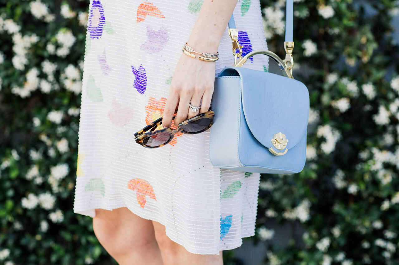 pale blue shoulder bag with floral sequin dress