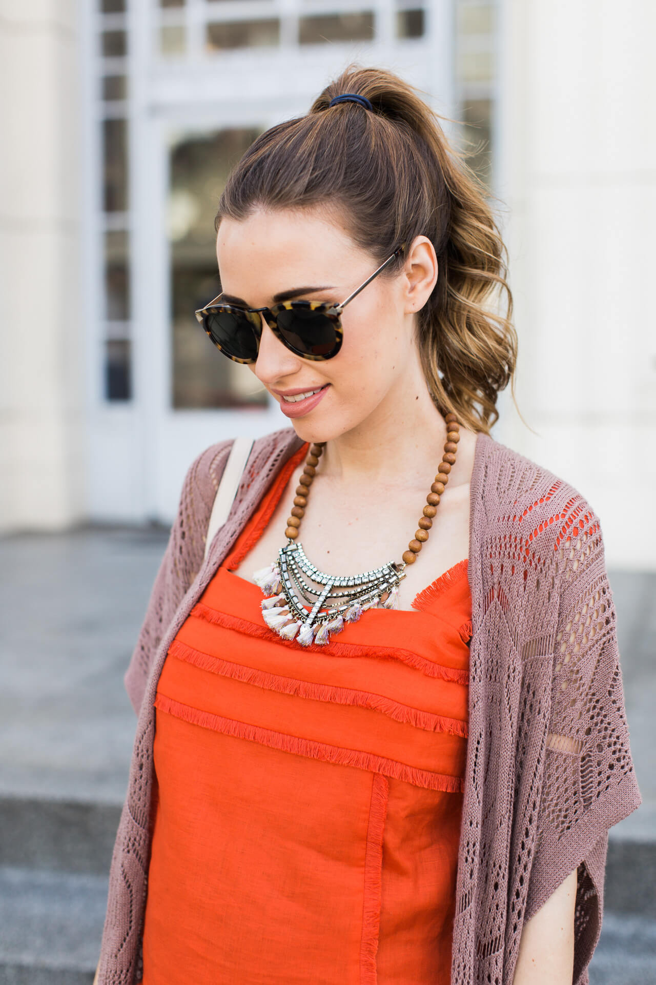 orange fringe tank with statement wooden necklace
