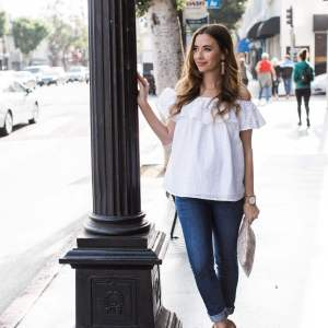white eyelet off the shoulder top with jeans