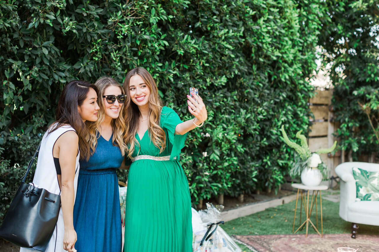 taking a selfie at a baby shower