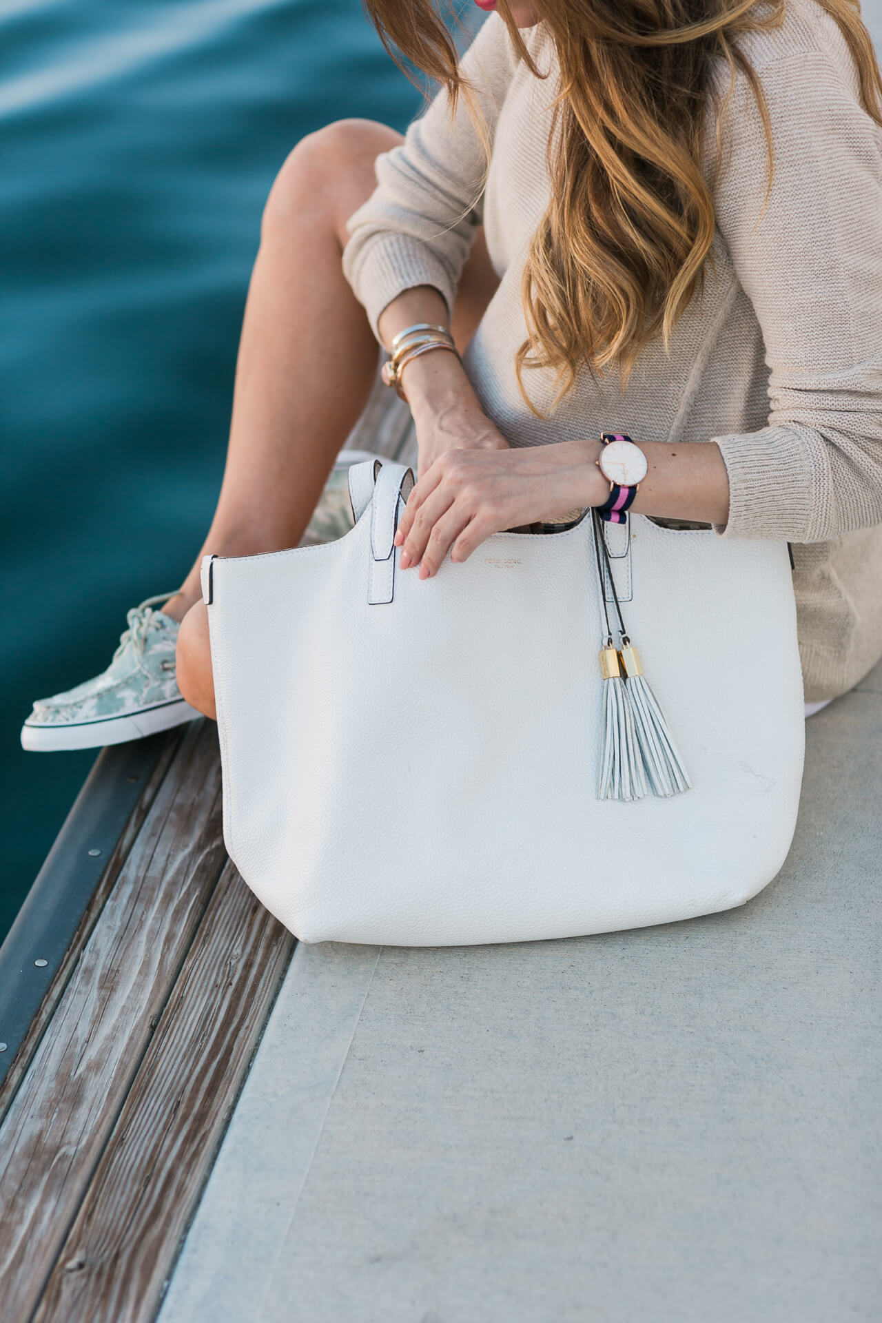 this white henri bendel tote with the tassel goes with absolutely everything!