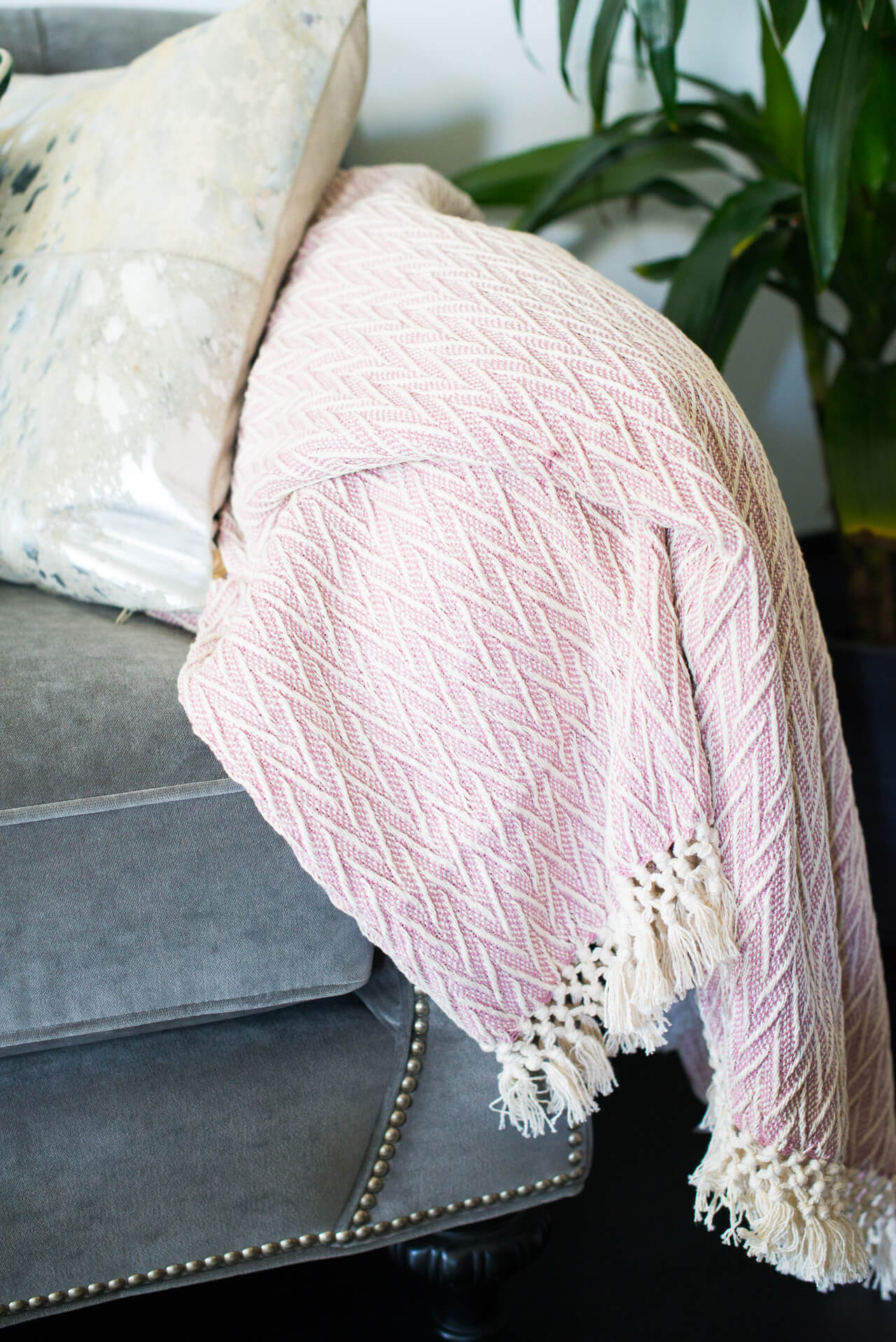 lavender knit throw on gray couch