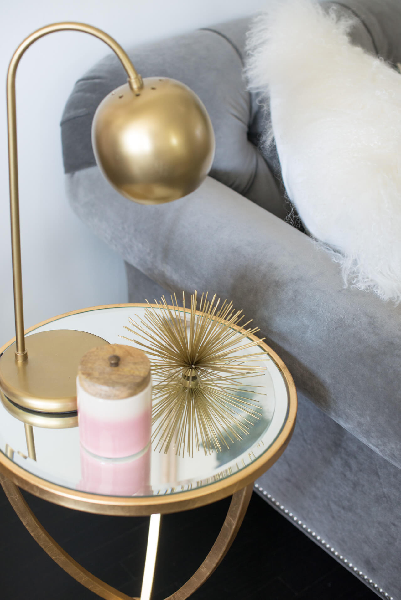 styling a side table with a brass urchin and candle