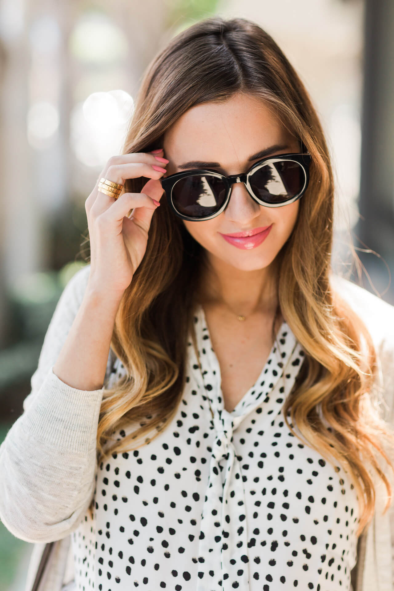 karen walker super duper sunglasses with a polka dotted blouse from banana republic