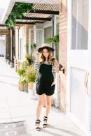 black overalls with striped top outfit post