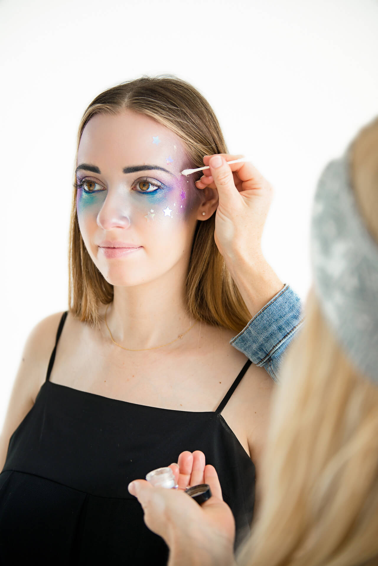 apply lash glue dots to face for the stars- Galaxy Girl Makeup Tutorial