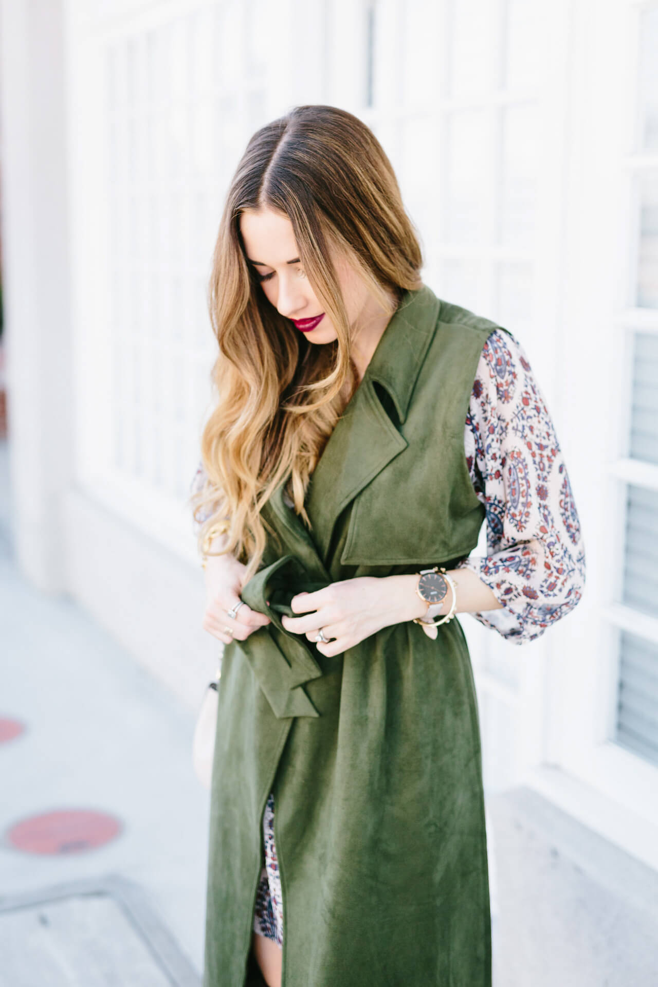 belted green suede trench with printed dress
