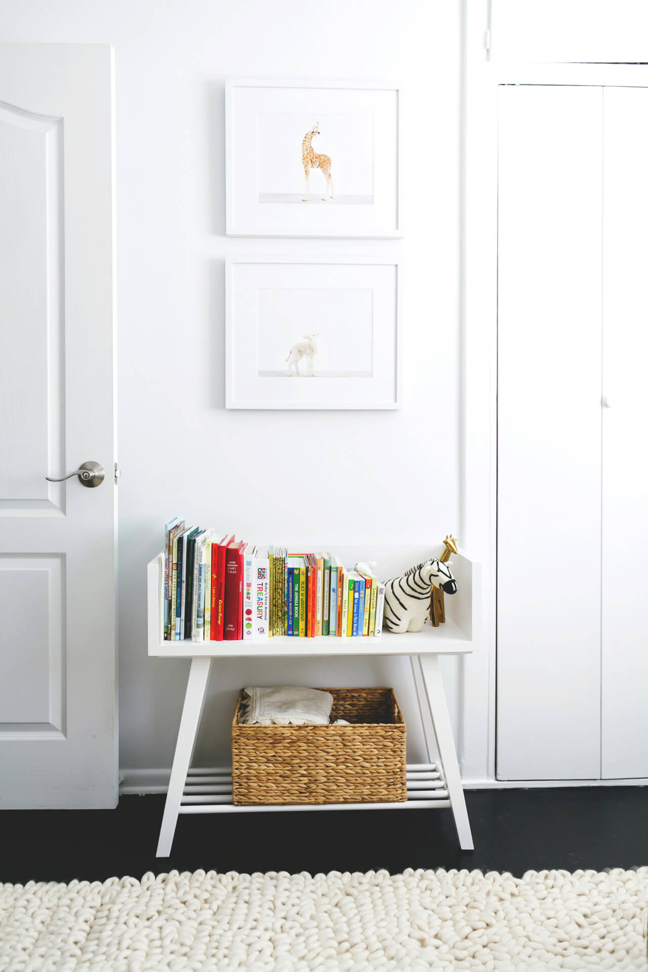 a cute white bookcase in a nursery