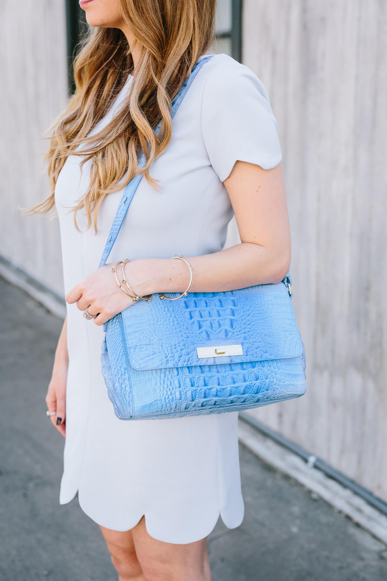 scalloped light blue dress with brahmin bag