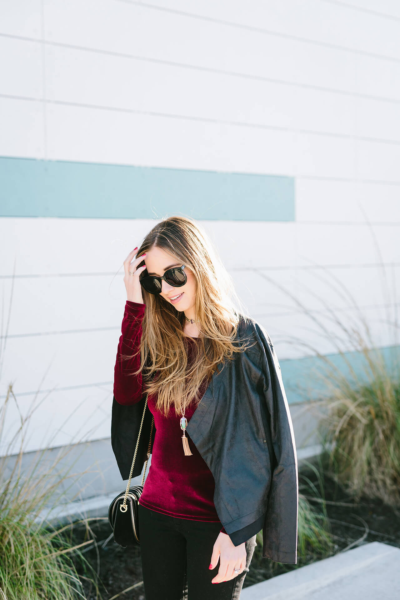 a burgundy velvet top with lysse faux leather jacket