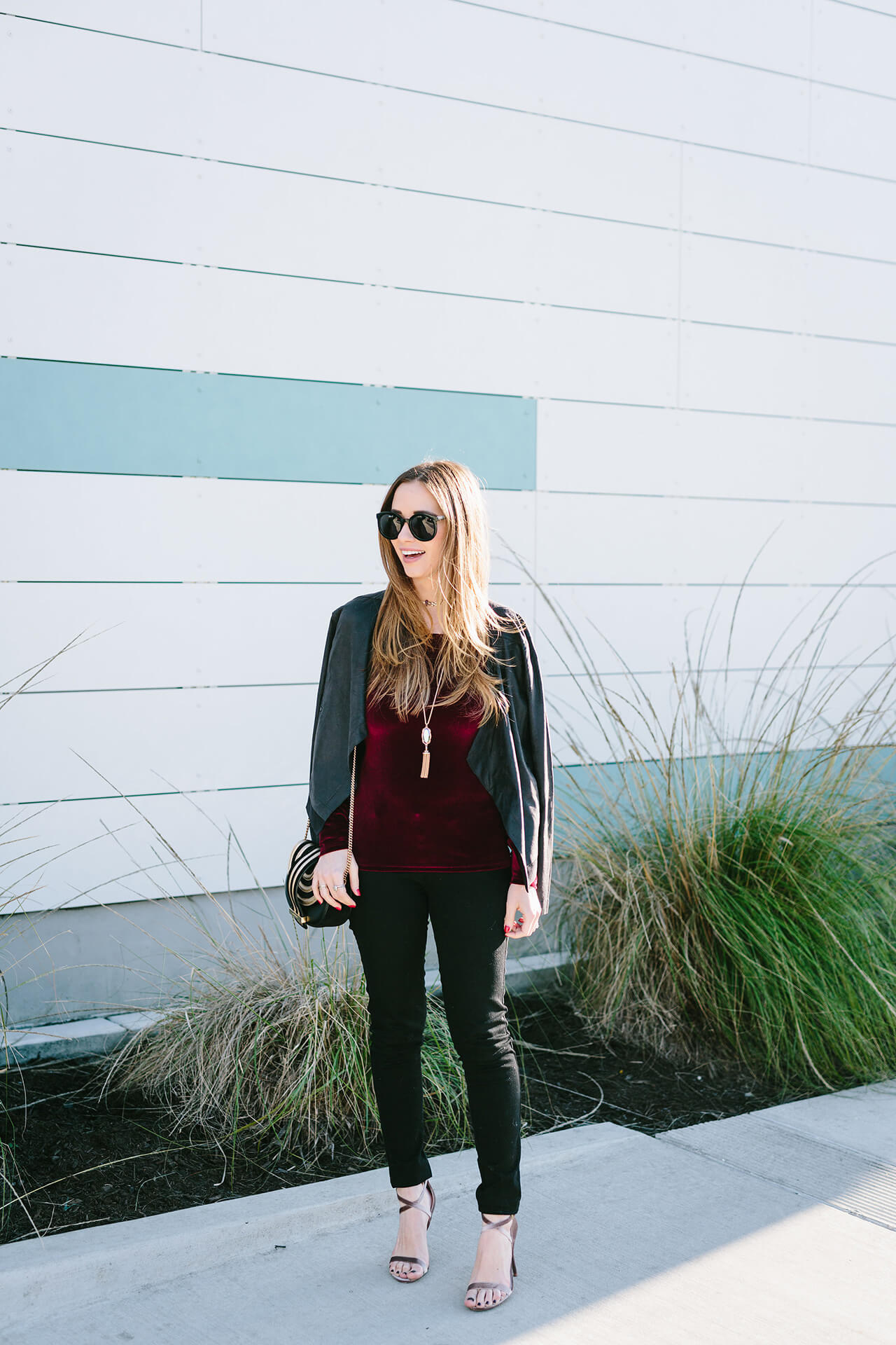 styling a velvet top with black pants for a casual holiday outfit