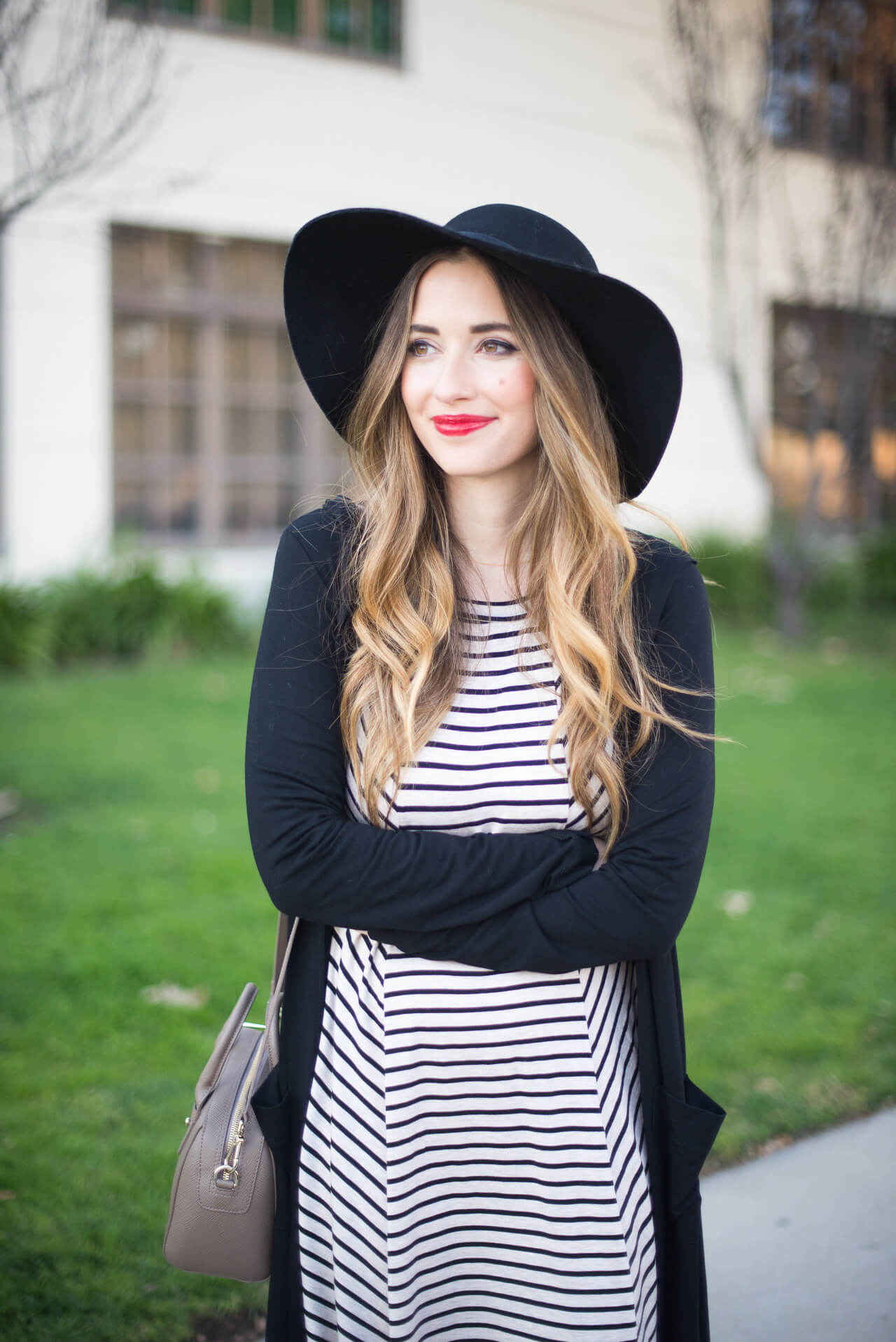 black hat with striped dress