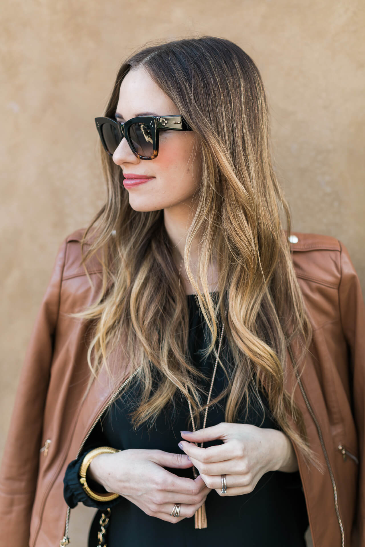 brunette hair with brown leather jacket