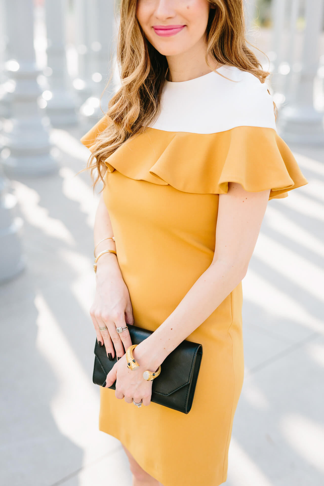 the most darling mustard dress with ruffle collar detail