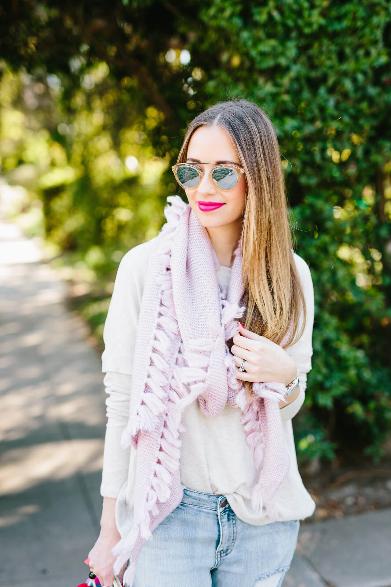beige sweater with pink scarf