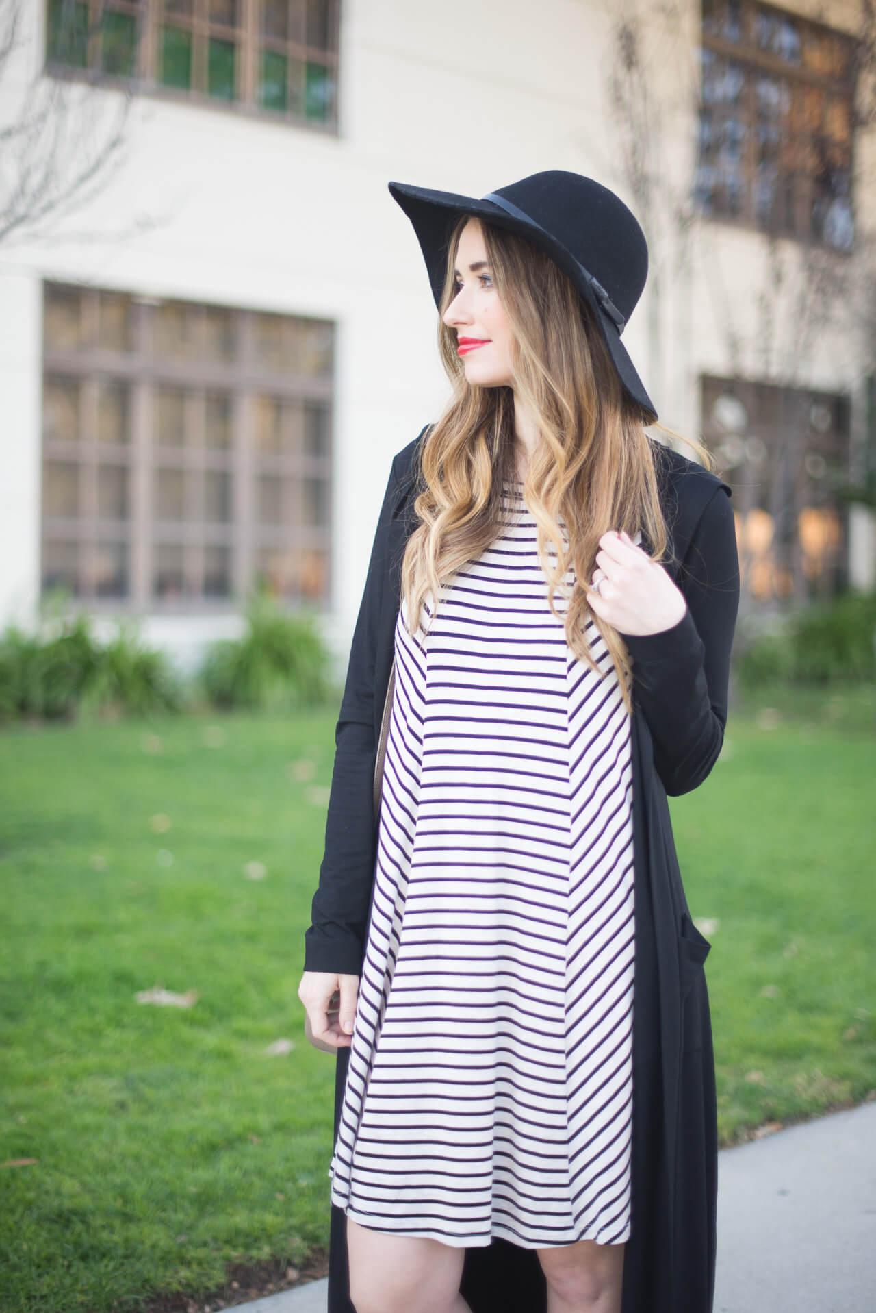 black floppy hat and striped dress