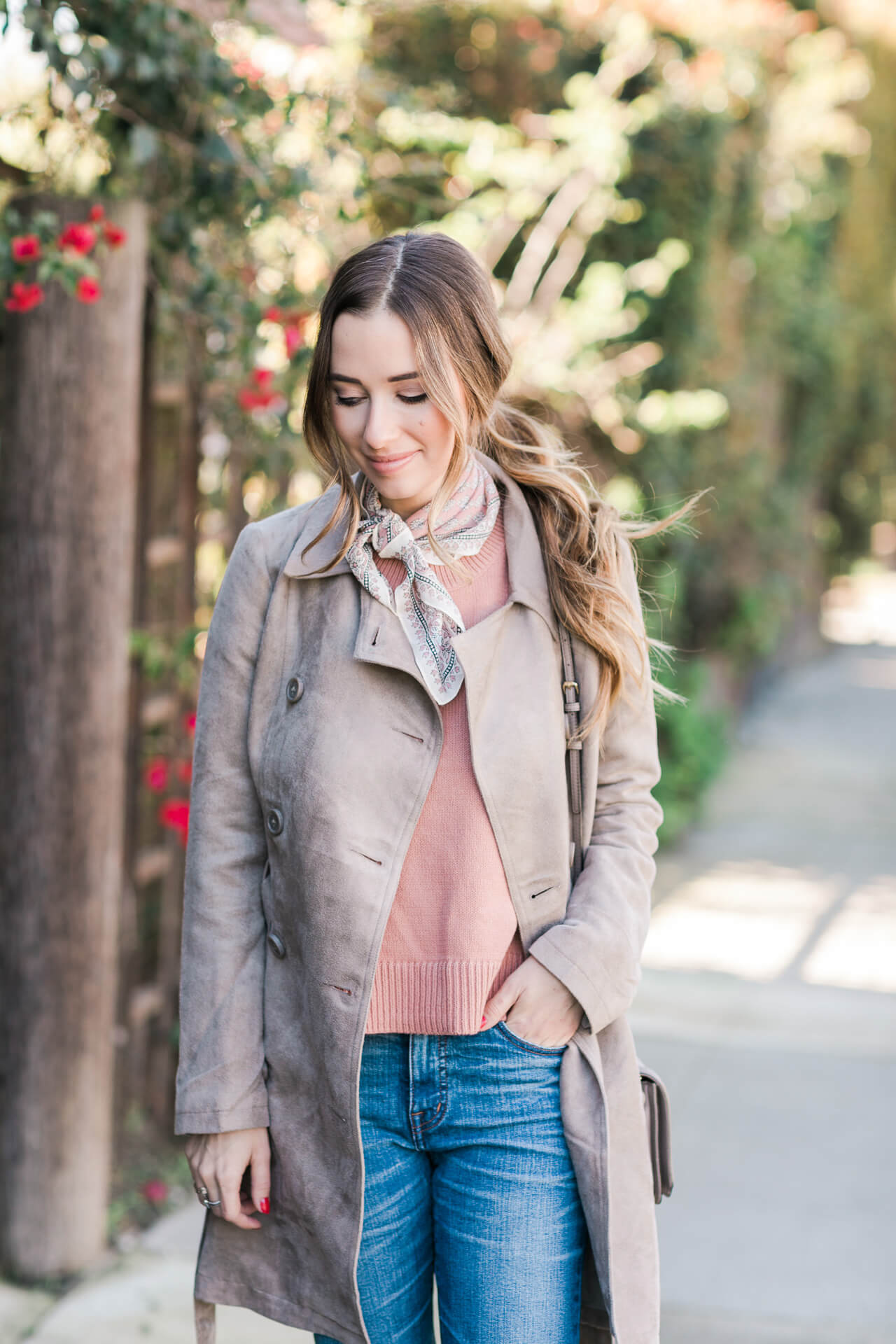 subtle valentine's day outfit inspiration- suede trench, pink sweater and jeans