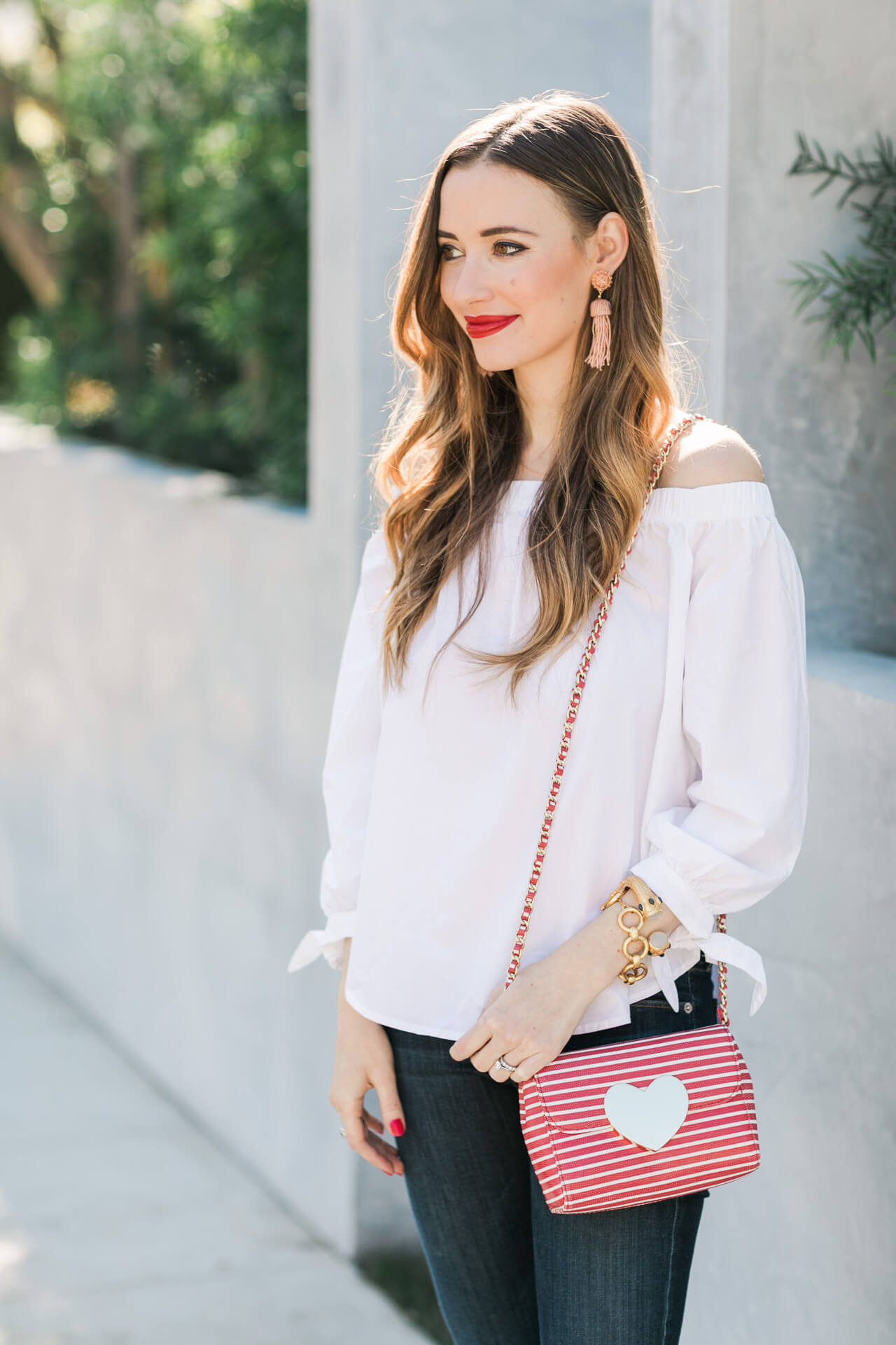 Valentine's Day outfit idea - white off the shoulder top with striped heart bag