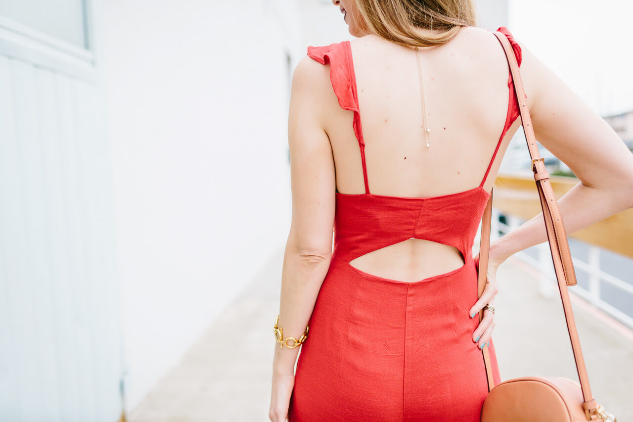 cut-out detail on the back of a ruffled jumpsuit