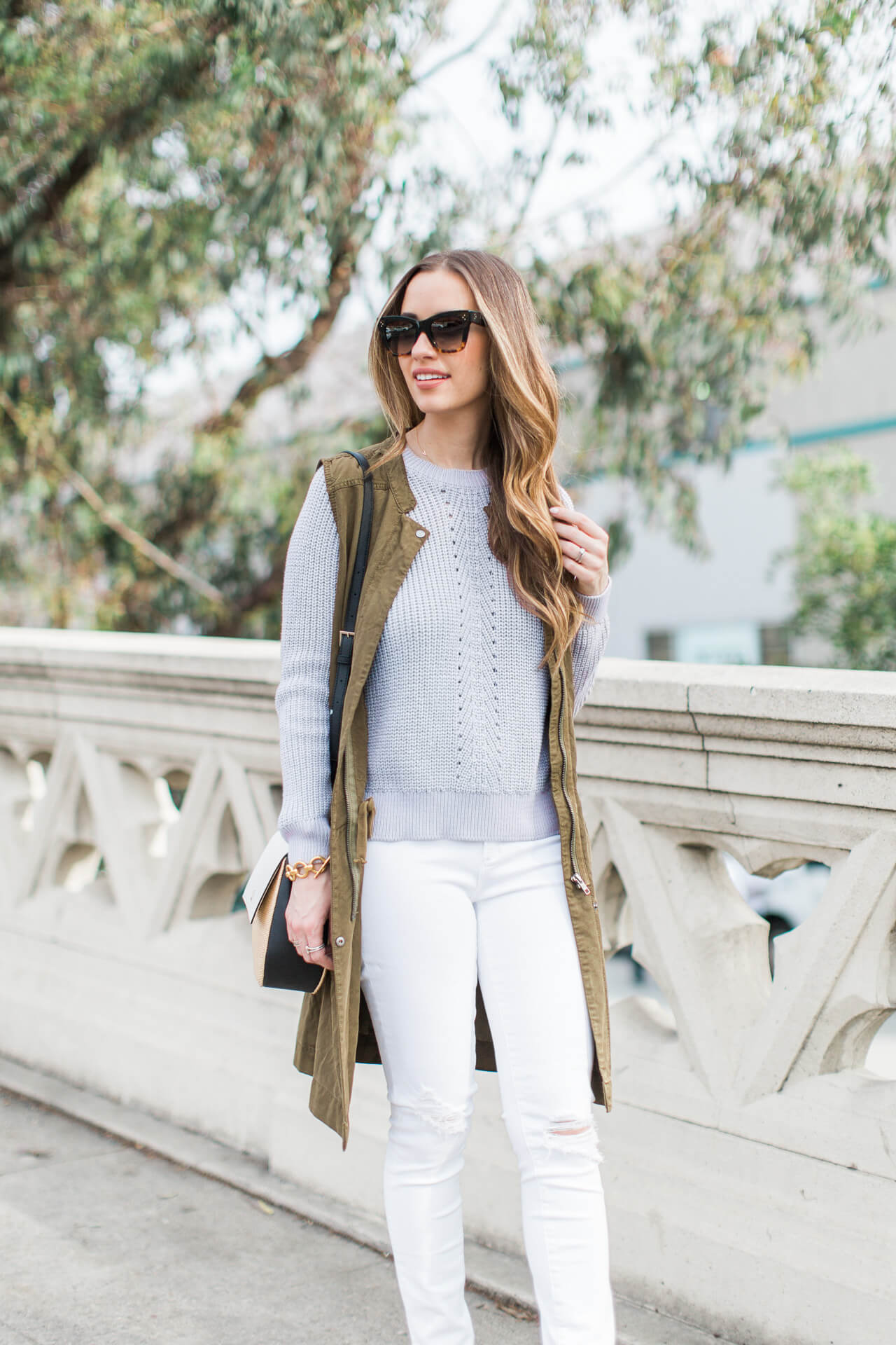 green utility vest with lavender topshop sweater and white jeans