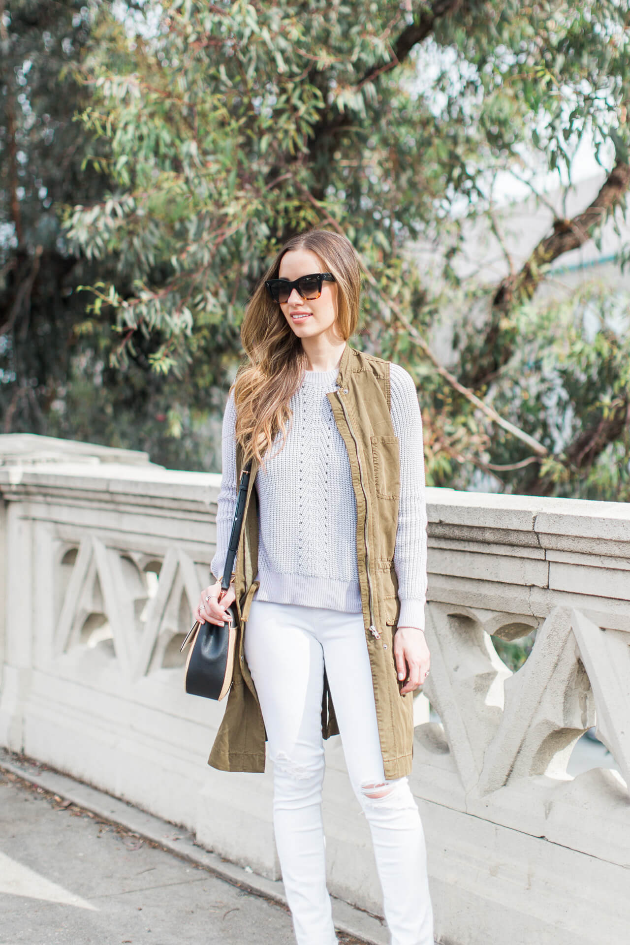 lavender knit sweater with white jeans