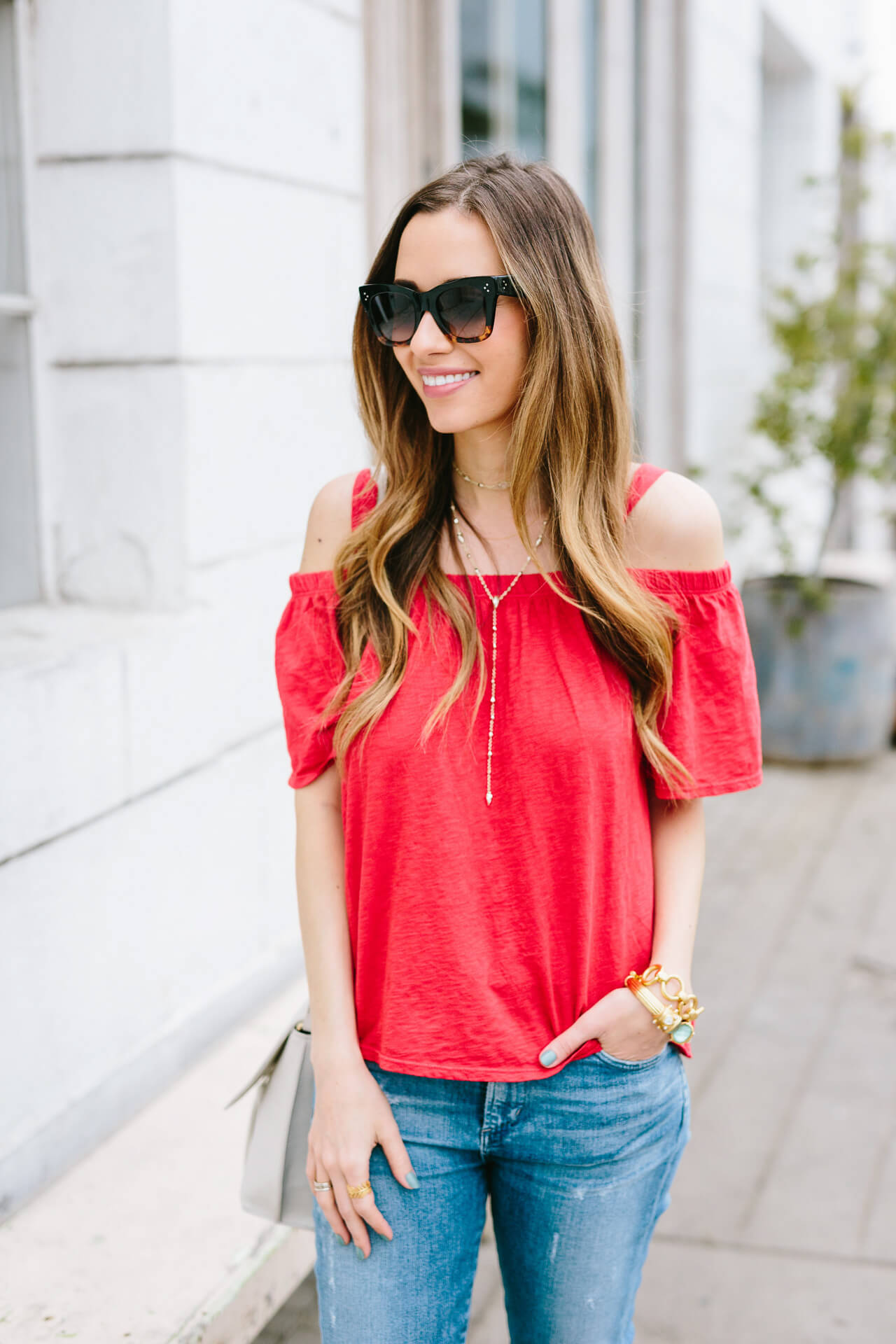 red cold shoulder top with jeans