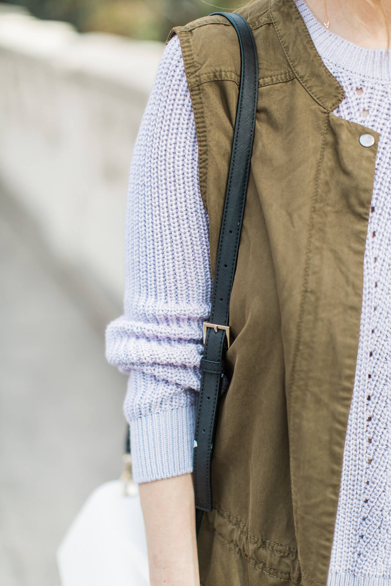 love this sleeveless utility vest with a sweater