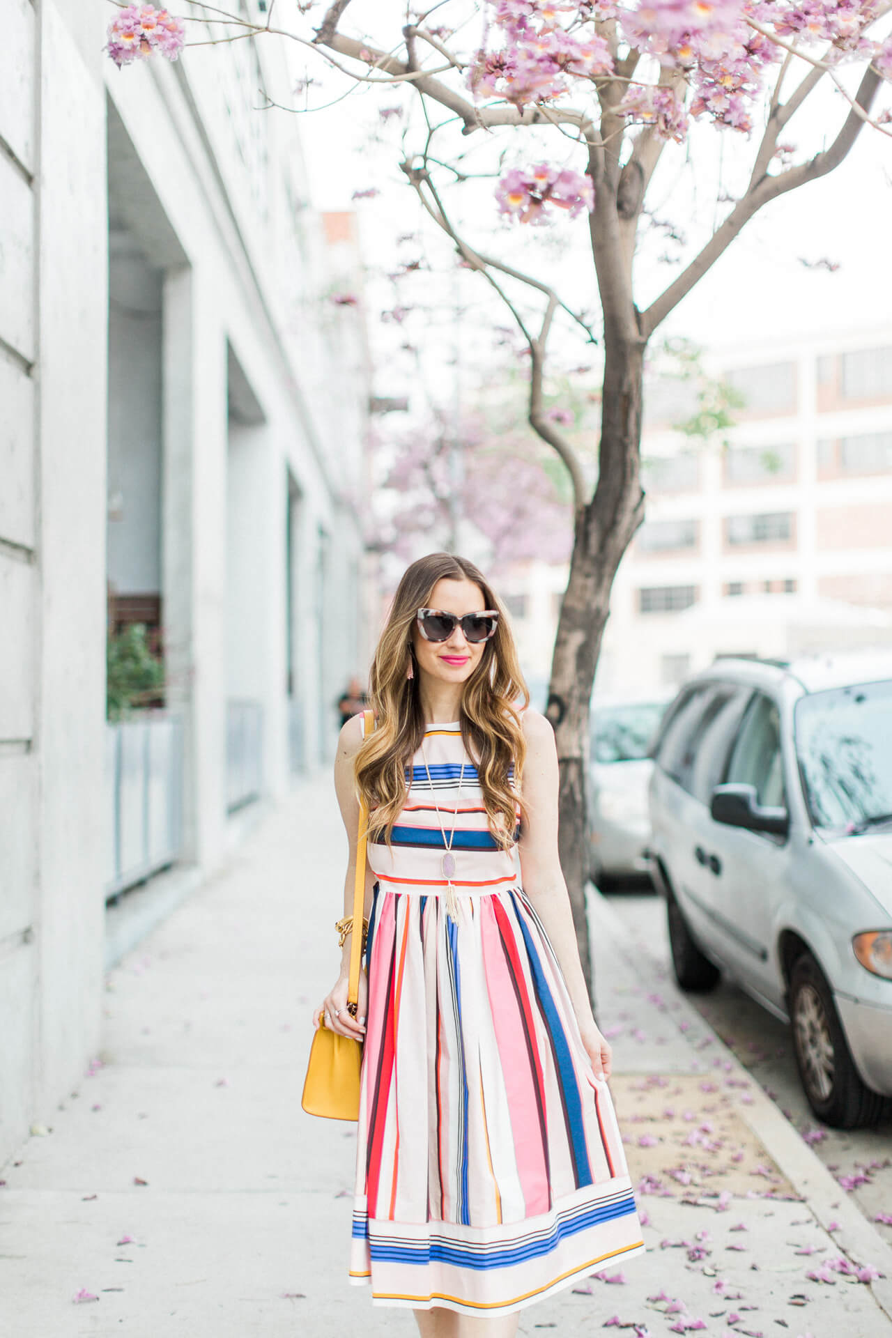 how fun is this colorful fit and flare striped dress?! - spring outfit inspiration!