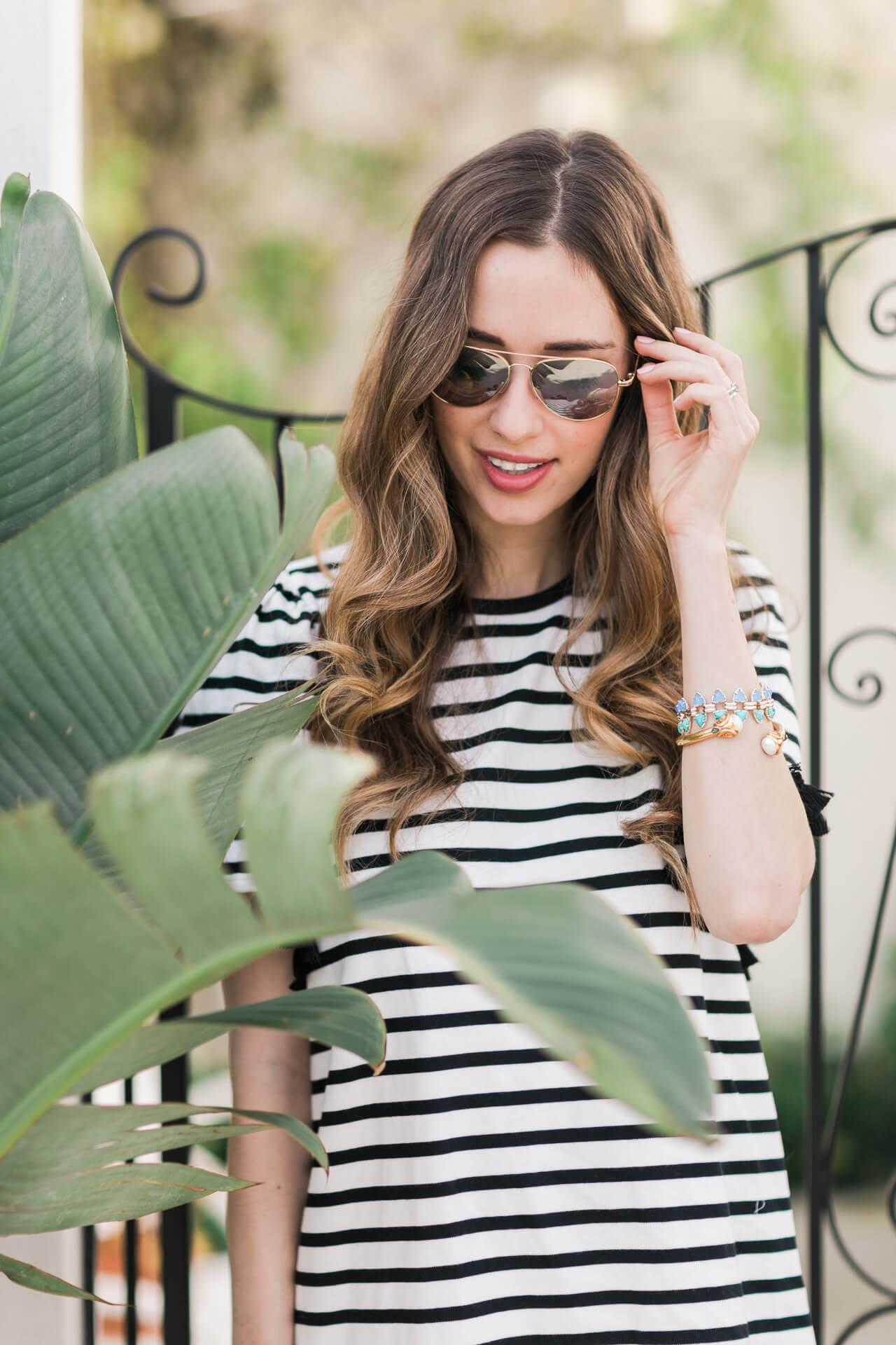 striped dress with aviator sunglasses