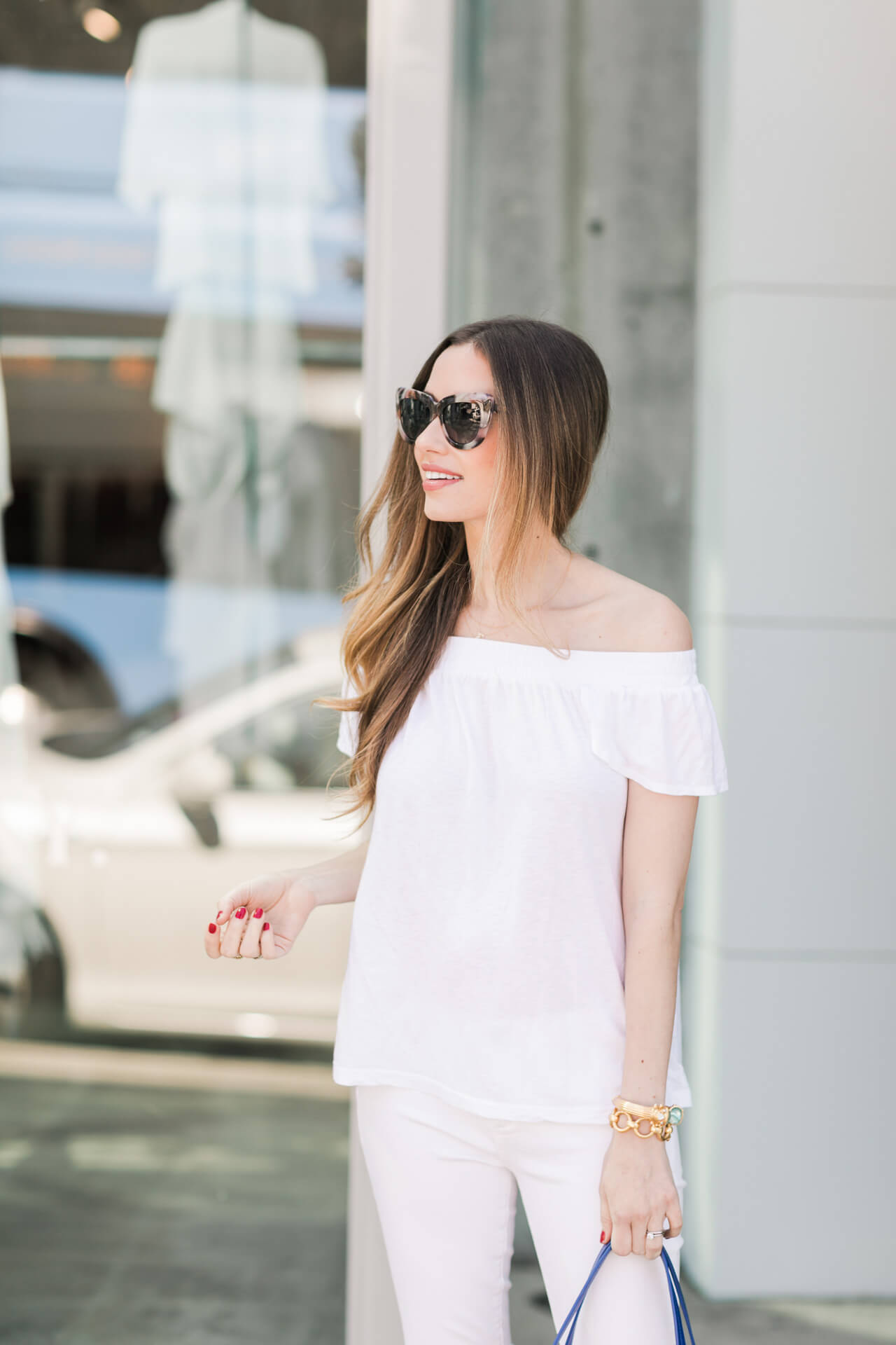 all white outfit inspiration: white off the shoulder top with white distressed jeans