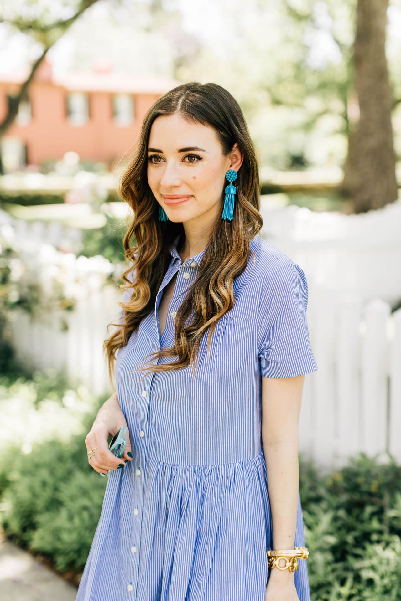 blue striped dress with blue tassel earrings- blue and white outfit inspiration for spring