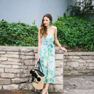 lemon print romper with straw bag