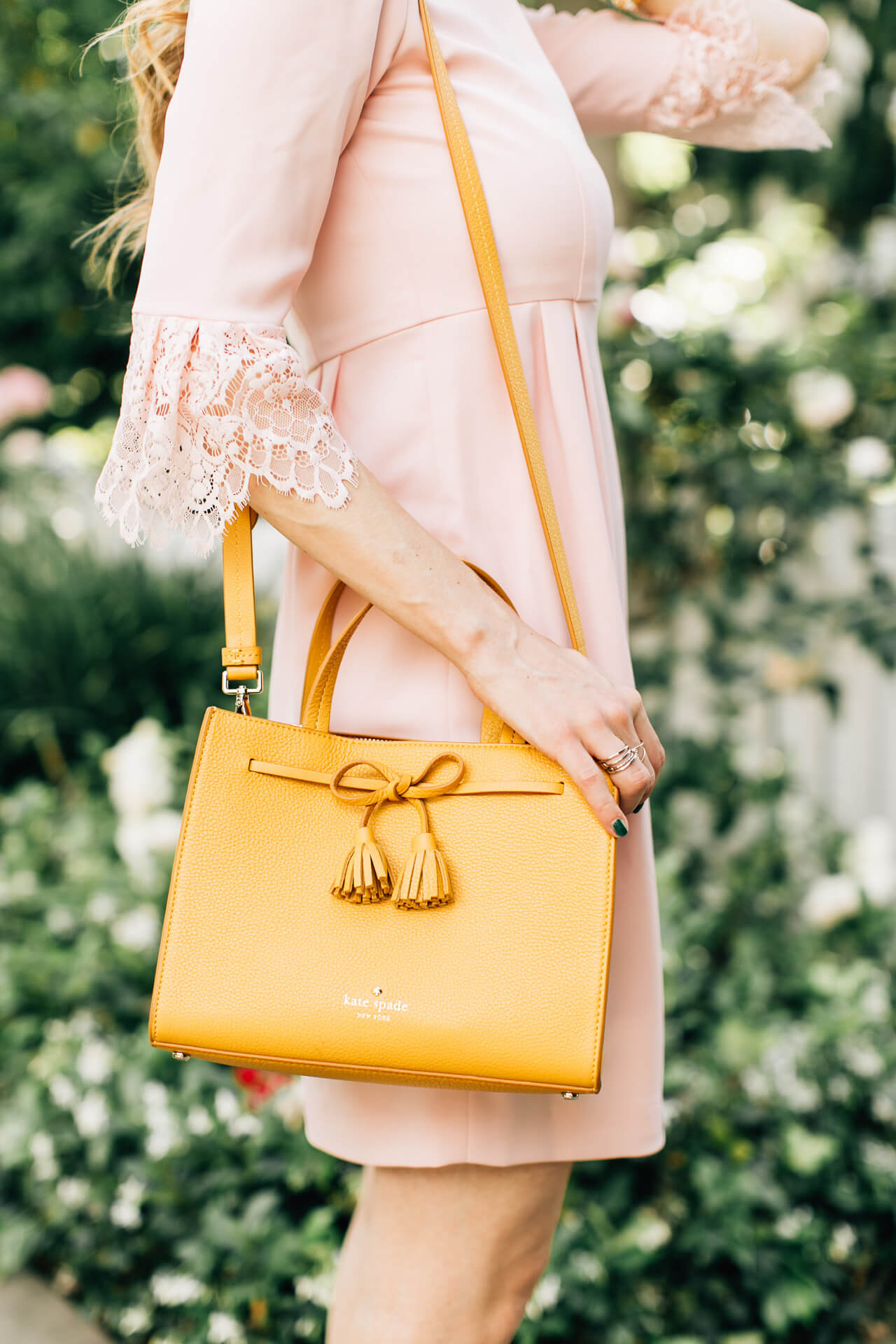 adore the lace sleeves on this dress as well as this mustard bag with a tasseled bow by kate spade