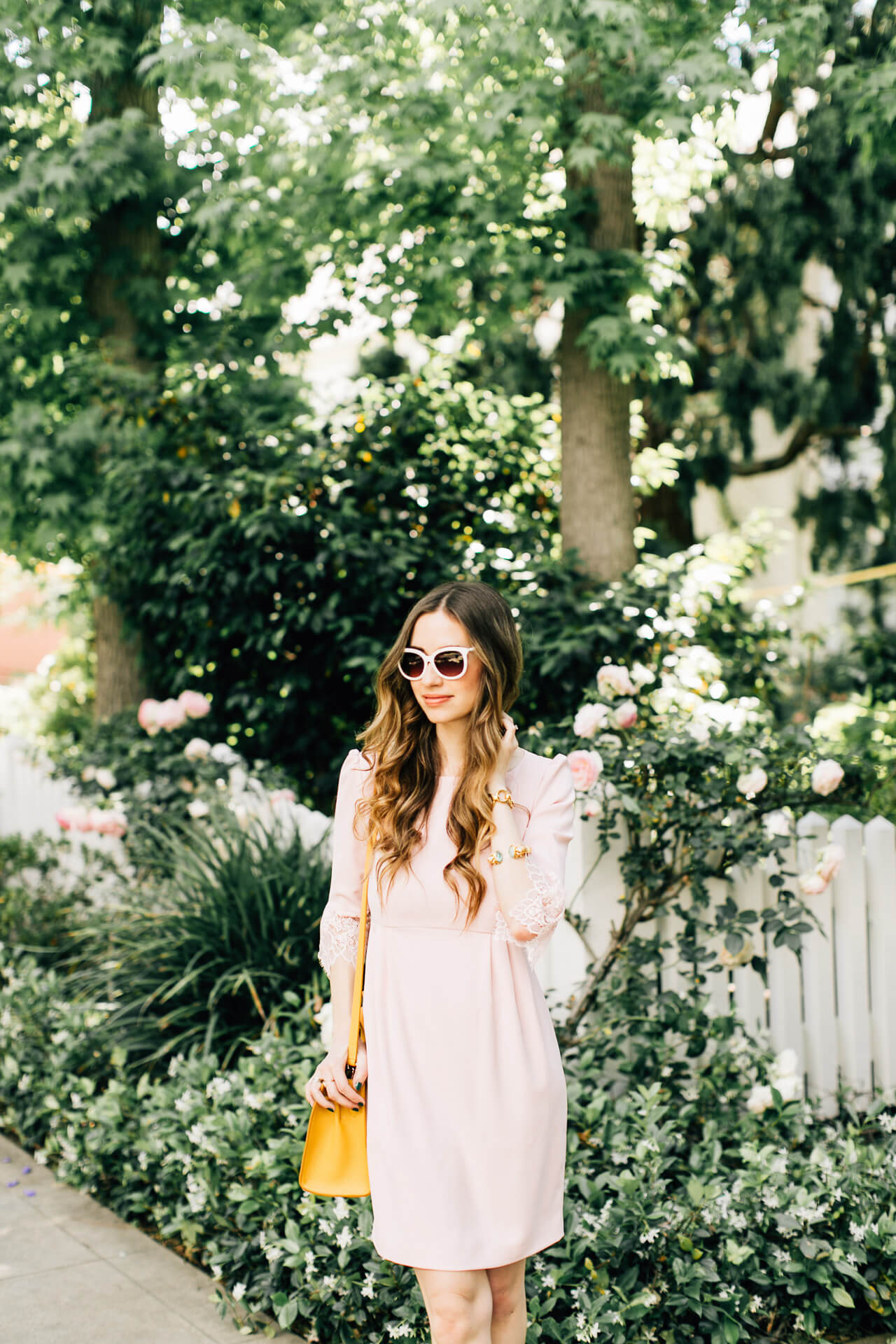 pink lace dress with white sunglasses - feminine outfit inspiration from LA fashion blogger M Loves M