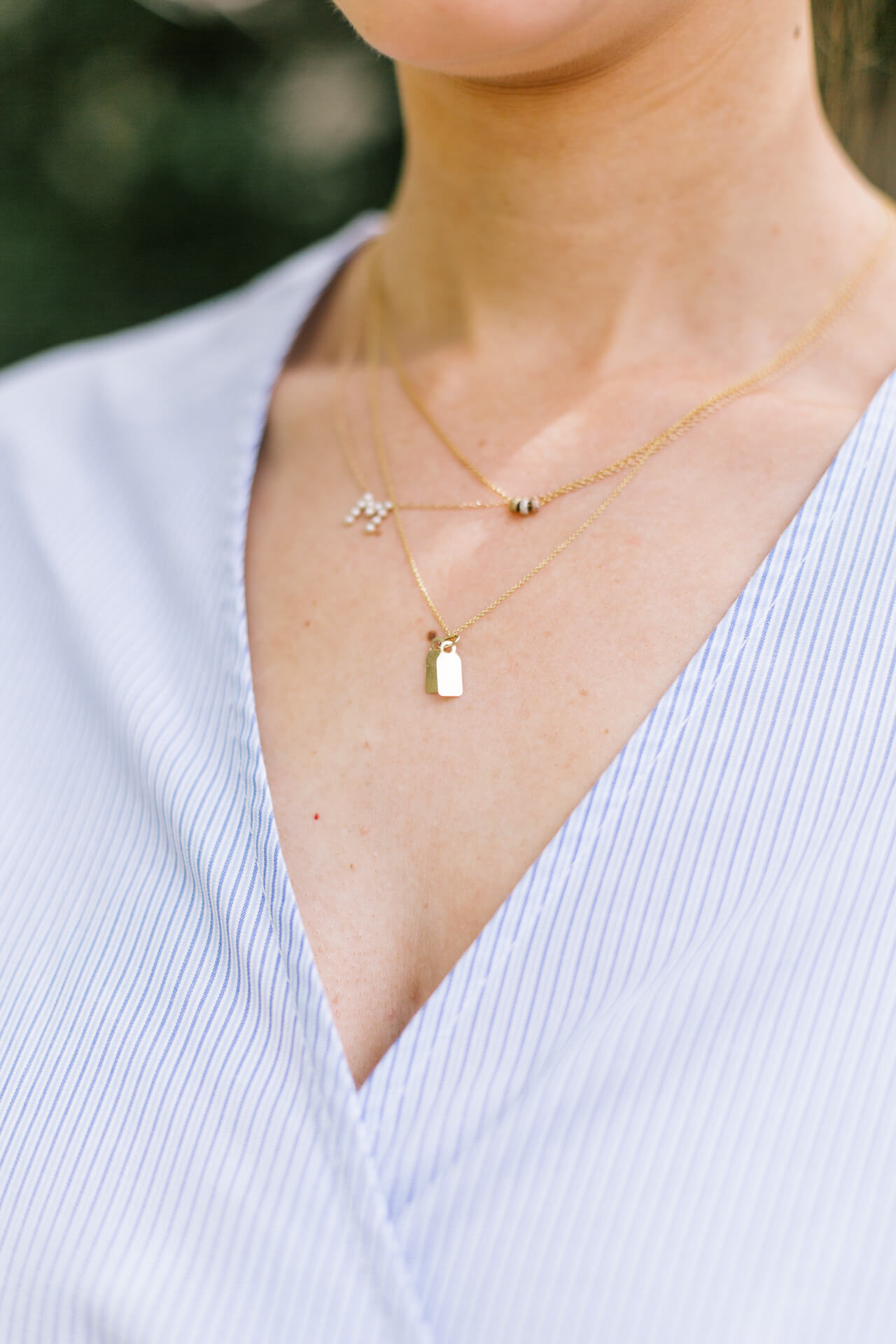delicate necklace layering