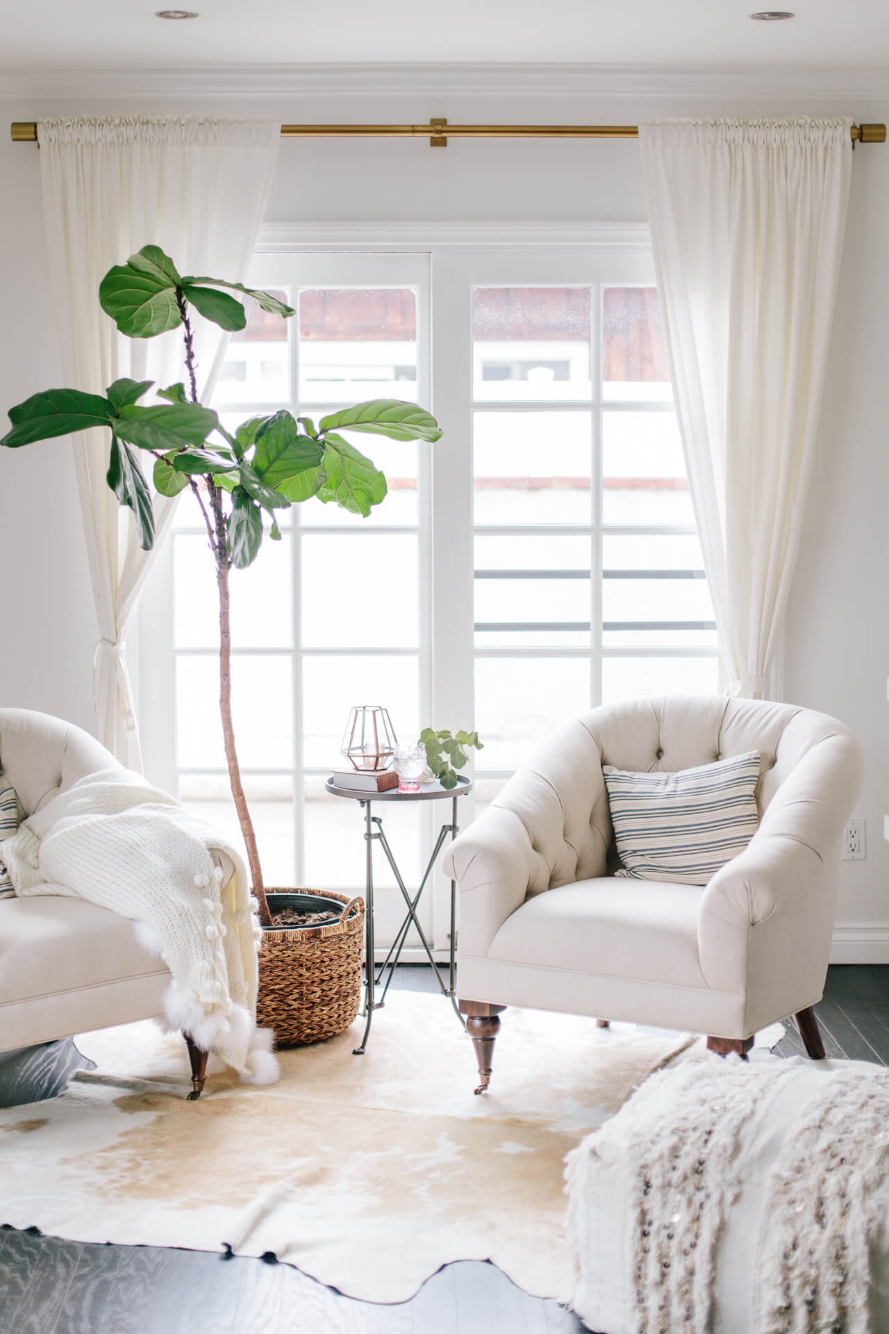 living room inspiration with two tufted chairs