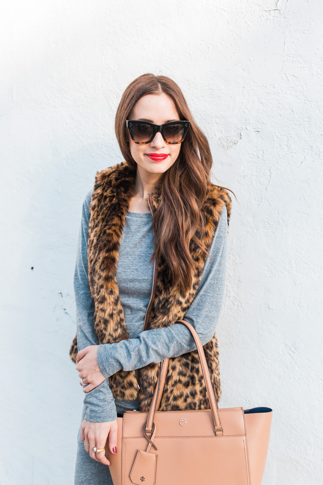 Keeping it classy with this faux fur leopard print vest