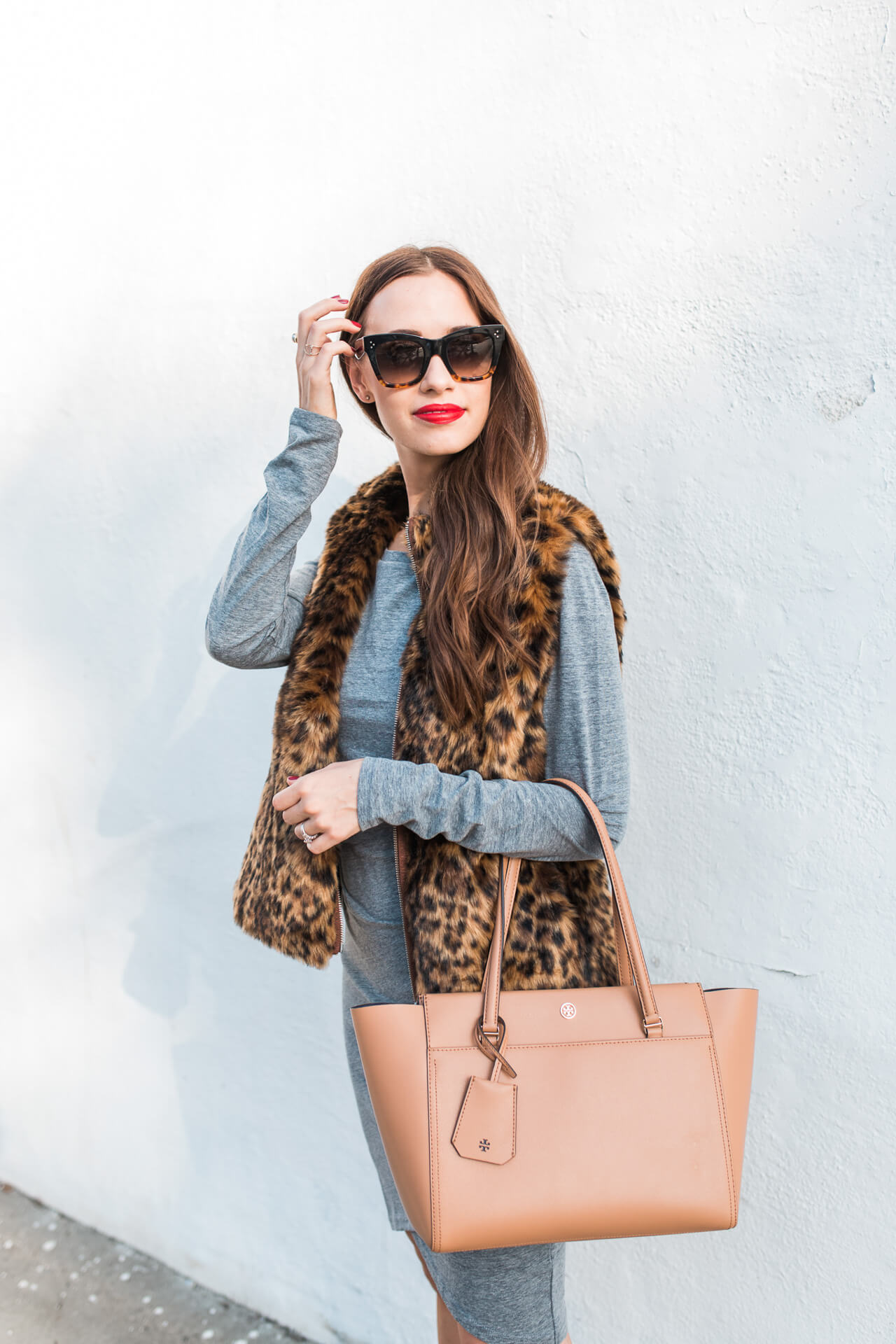 styling a red lipstick look for fall with gray and leopard