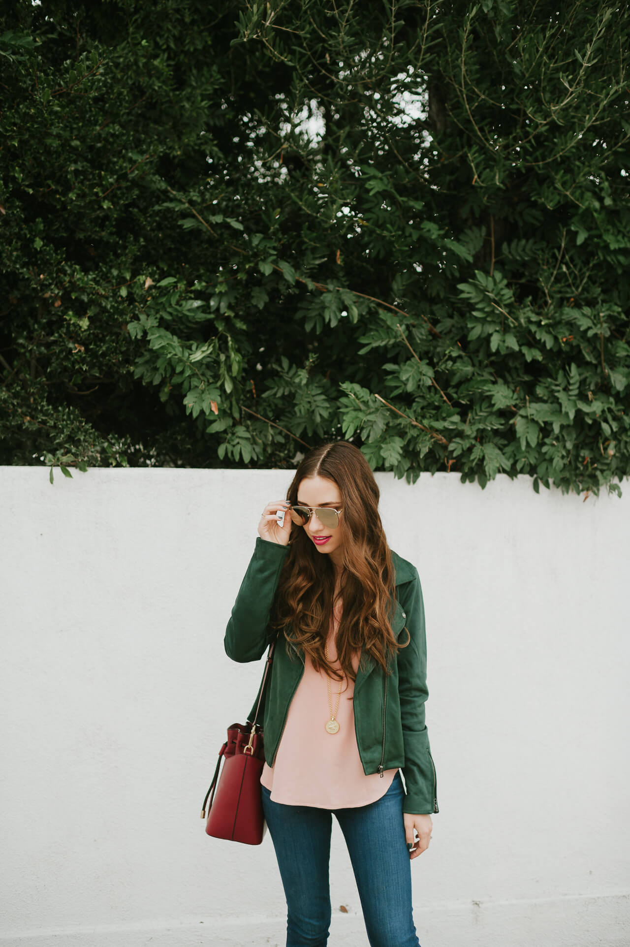 cute fall outfit inspiration with green suede moto jacket