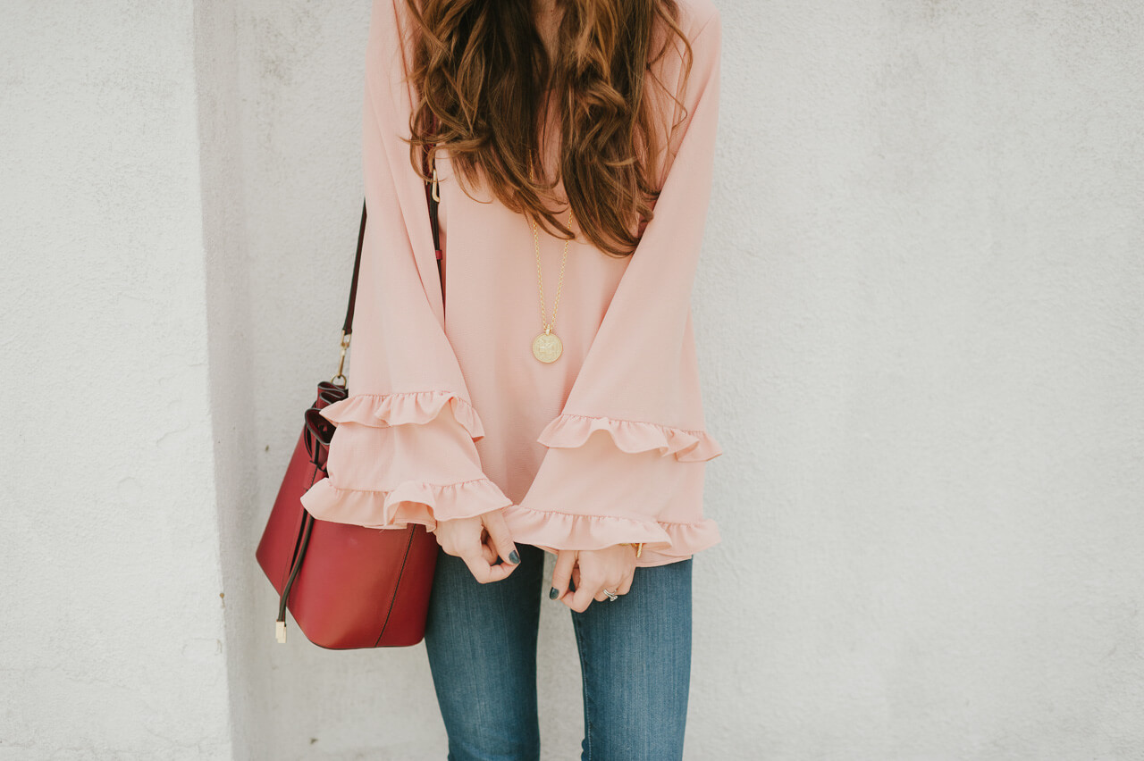 this pink ruffled bell sleeve blouse is a must-have!