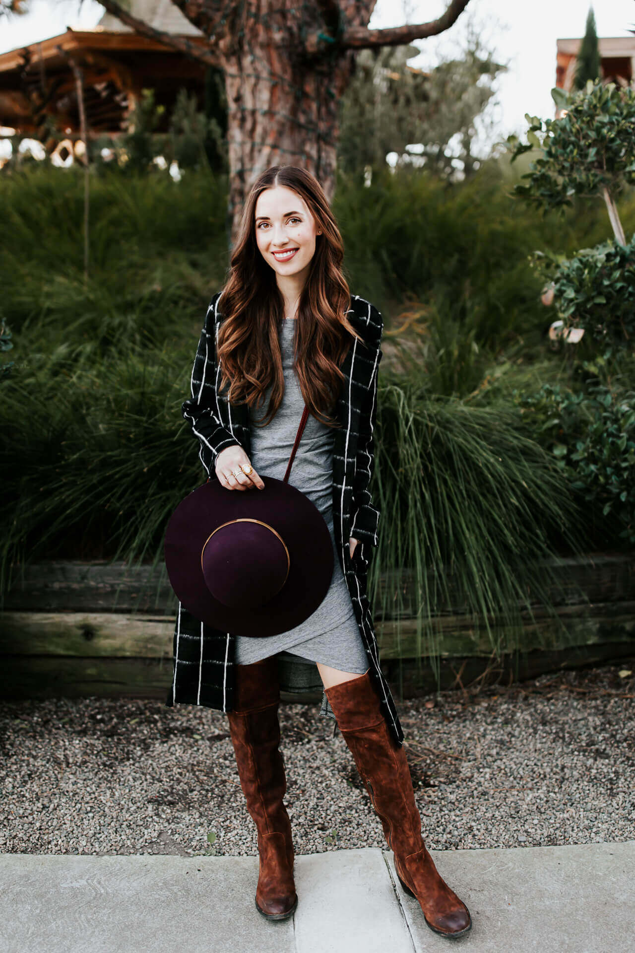 a plaid coat with gray dress and over the knee boots
