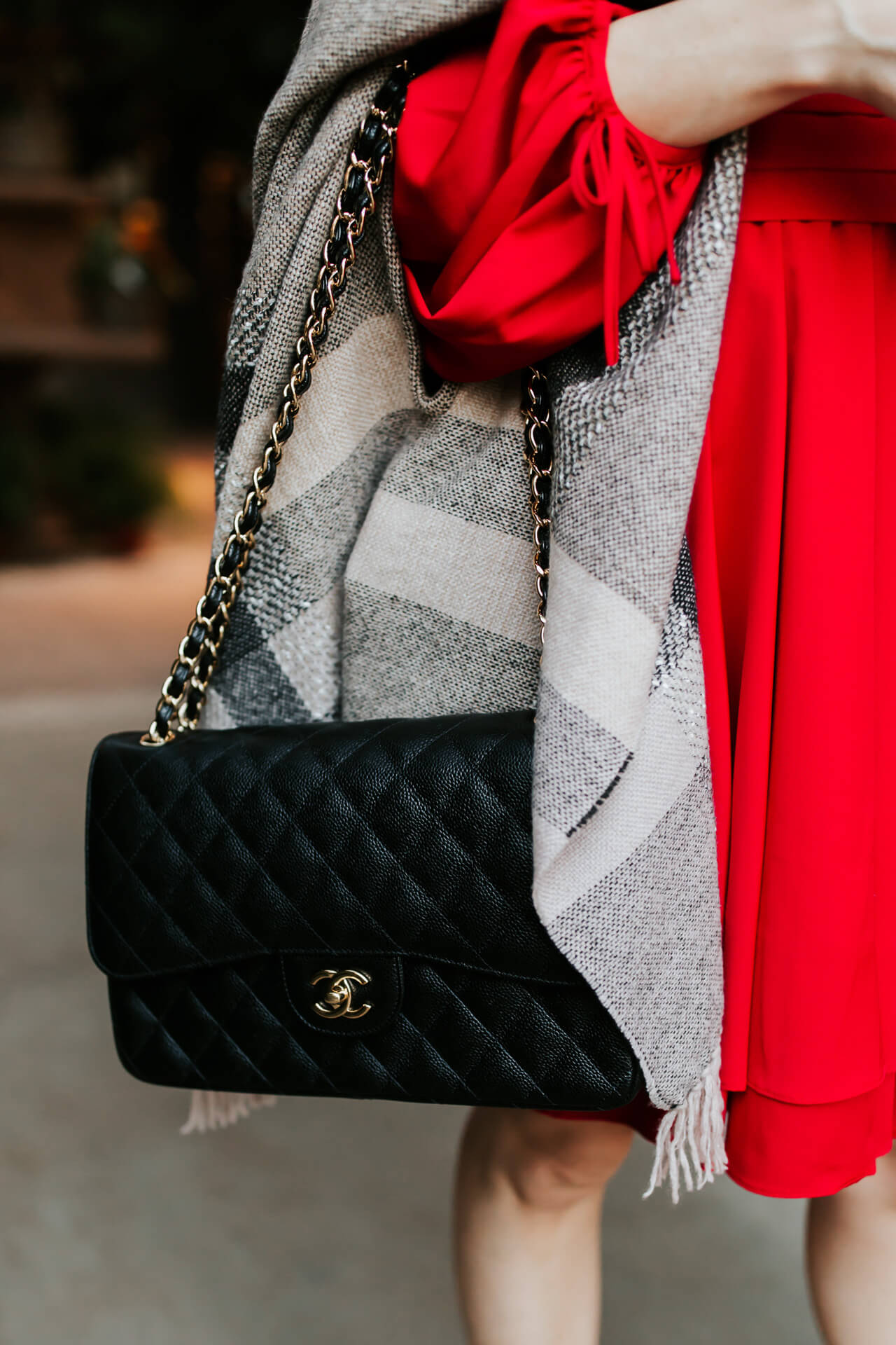 i rarely wear black bags but love the contrast with this red dress