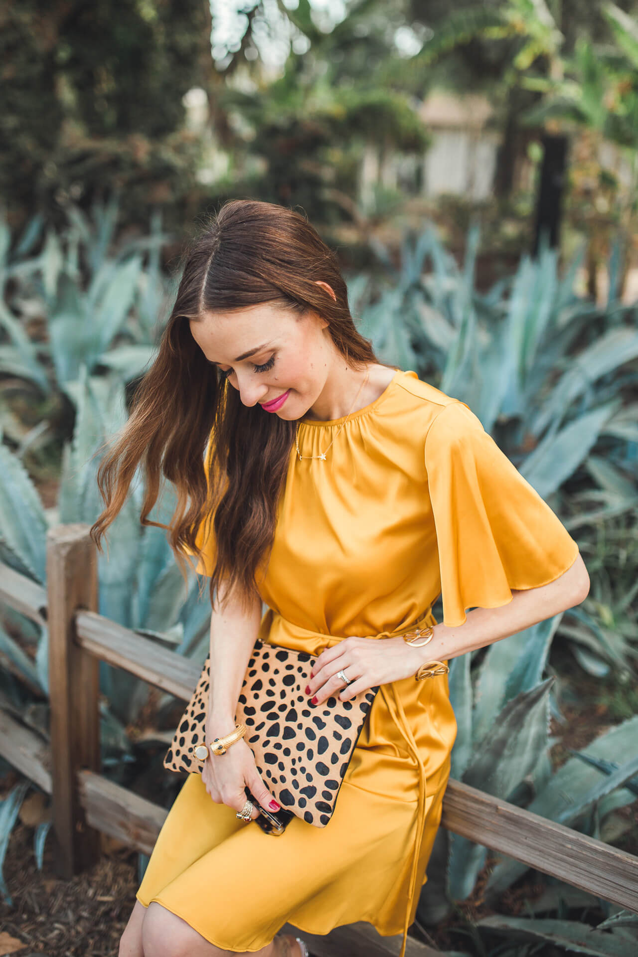 mustard dress with leopard clutch