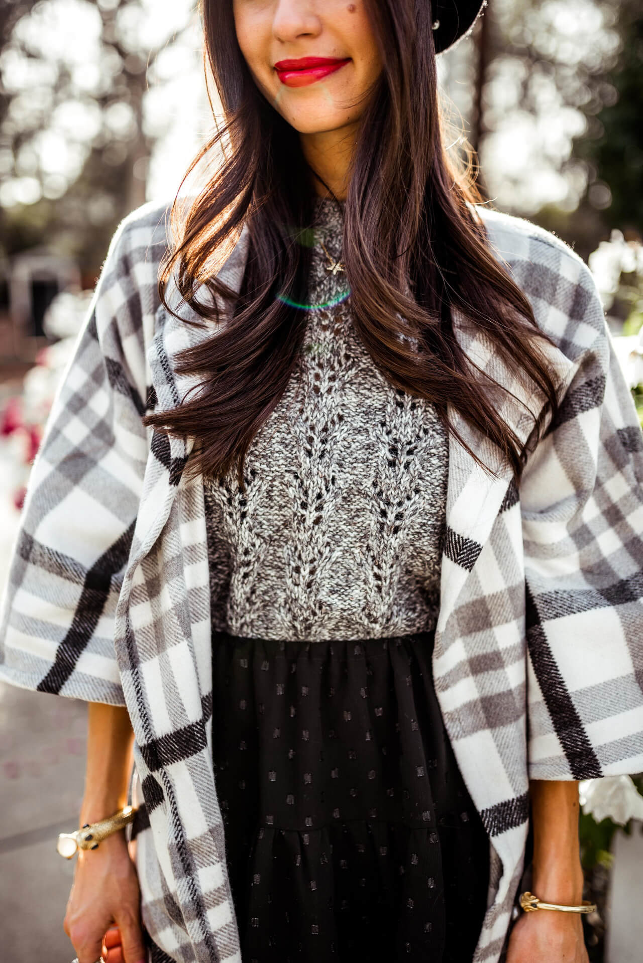 the coziest plaid poncho for this time of year