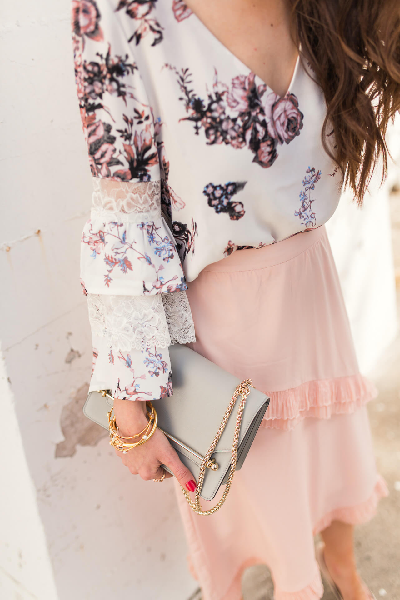 feminine and ruffled blouse with pink tiered skirt