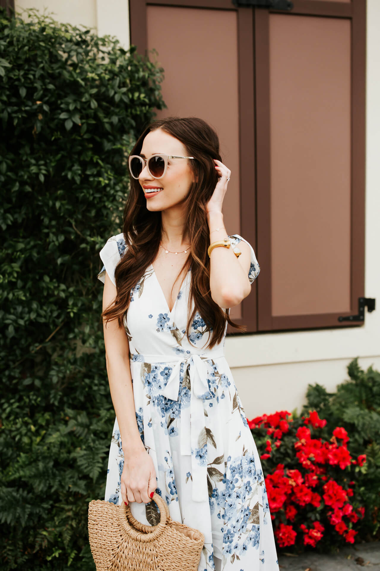 a feminine blue and white floral dress on Los Angeles fashion blogger M Loves M